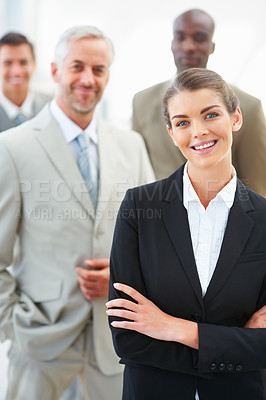 Buy stock photo Cute business woman with hands folded and team at the back