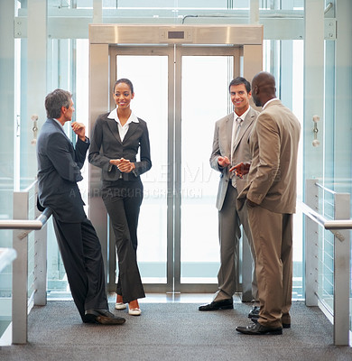Buy stock photo Portrait of a team of business people at the building entrance