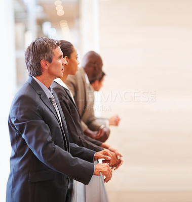 Buy stock photo Portrait of successful business colleagues by a railing, looking at copyspace