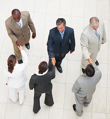 Buy stock photo Upward view of a business people shaking hands