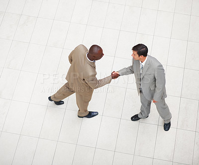Buy stock photo Above view of a two business men greeting eachother