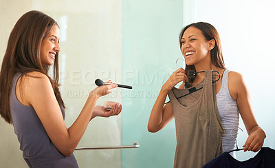 Buy stock photo Shot of an attractive young woman asking her friend for advice on what to wear