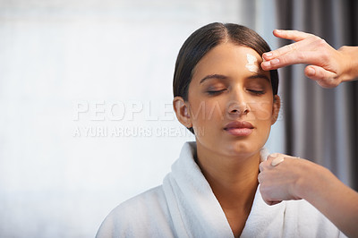 Buy stock photo Shot of an attractive young woman having a facial mask applied