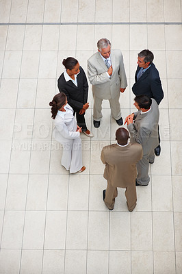 Buy stock photo Upward view of a group of business people standing together