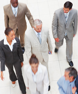 Buy stock photo Upward view of a group of business colleagues, walking