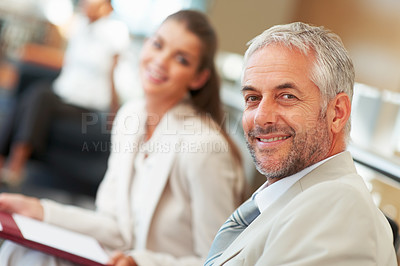 Buy stock photo Mature business man with a colleague at the background