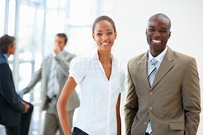 Buy stock photo An African American business man and woman laughing together