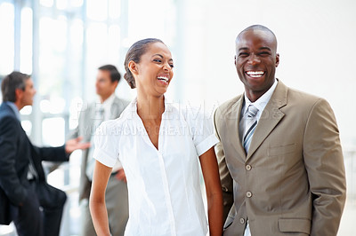 Buy stock photo An African American business man and woman laughing