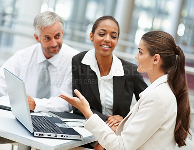 Buy stock photo Young business woman working with team on a laptop
