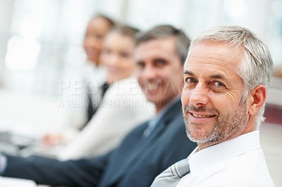 Buy stock photo Portrait of a successful business man with his team behind him