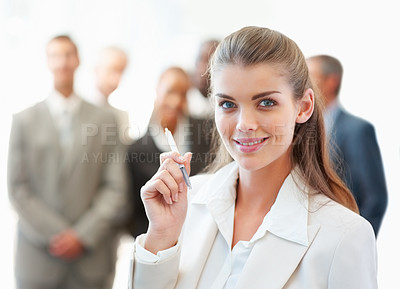 Buy stock photo Cute young business woman with colleagues at the background