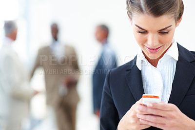 Buy stock photo Young business woman messaging on her mobile phone
