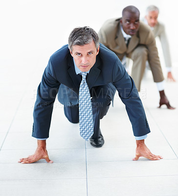Buy stock photo Elderly business man in position for a race