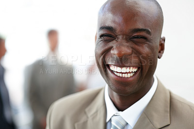 Buy stock photo Closeup portrait of a cheerful African American business man laughing heartily while looking at the camera - copyspace