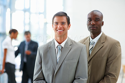 Buy stock photo Portrait of two successful business colleagues together at their workplace