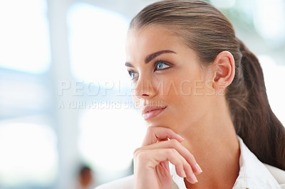 Buy stock photo A creative young business woman looking away with hand on her chin