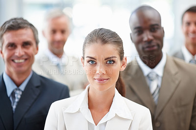 Buy stock photo Portrait of an attractive business woman with team at the back