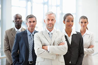 Buy stock photo Portrait of a team of business people confidently standing together