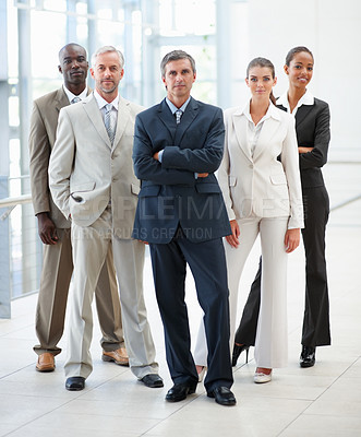 Buy stock photo Portrait of a confident successful team of business colleagues posing together