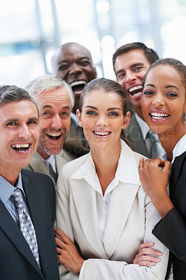 Buy stock photo Portrait of a satisfied group of business people smiling together