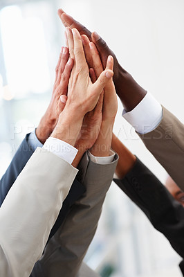 Buy stock photo Closeup of a multiracial hands raised together in agreement
