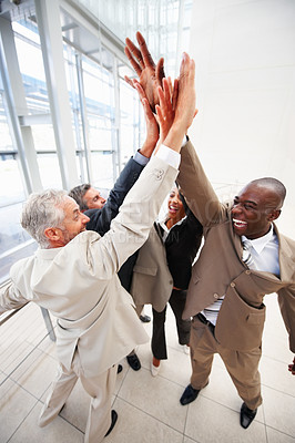 Buy stock photo Portrait of a cheerful business people with their hands raised together in agreement