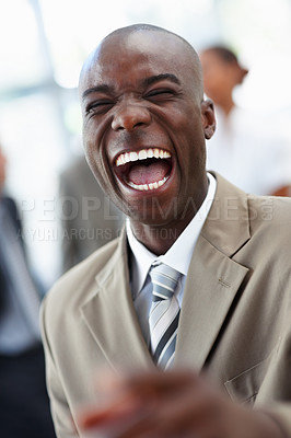 Buy stock photo A laughing cheerful African American business man