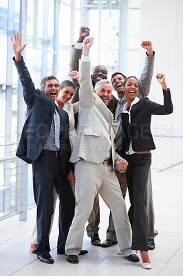 Buy stock photo Full length portrait of successful delighted business people with their hands raised