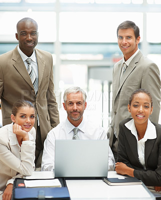 Buy stock photo A senior mature business man sitting in the office with a team of colleagues