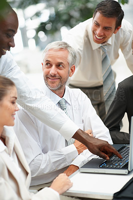 Buy stock photo A successful group of business people having fun while working