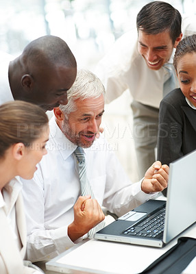 Buy stock photo An excited successful team of business people working together