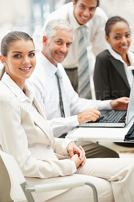 Buy stock photo Young business woman with team working at the background