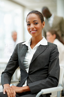 Buy stock photo A successful satisfied African American business woman sitting on a chair in the office