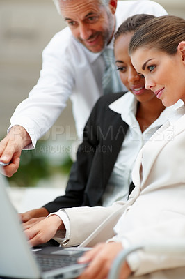 Buy stock photo Group of happy business people working on a laptop