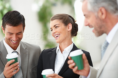 Buy stock photo Group of three business people enjoying their break time