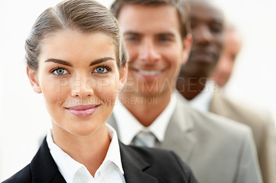 Buy stock photo Closeup of a beautiful young business woman with her colleagues at her back