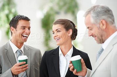 Buy stock photo Three ambitious and successful business partners enjoying a cup of coffee together