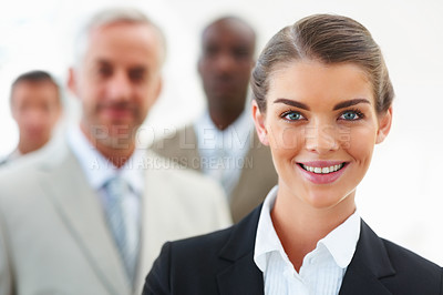 Buy stock photo Confident business woman with team at the back on white background