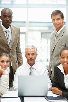 Buy stock photo Portrait of a senior business man sitting with a team of colleagues