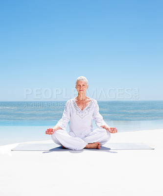 Buy stock photo Image of a relaxed senior mature woman meditating on the beach