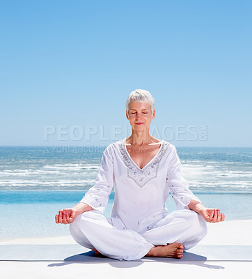 Buy stock photo Portrait of a relaxed old mature woman meditating on the beach