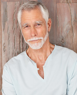 Buy stock photo Portrait of a senior man, smiling over a wooden background