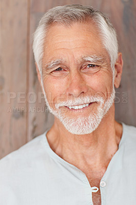 Buy stock photo Portrait of an elderly man, smiling over a wooden background