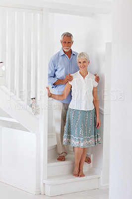 Buy stock photo Portrait of a cheerful old couple at their new home