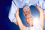 Upward view: Senior couple with their head together