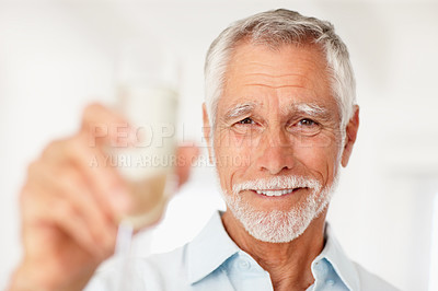 Buy stock photo Portrait of a happy mature man holding a glass of champagne