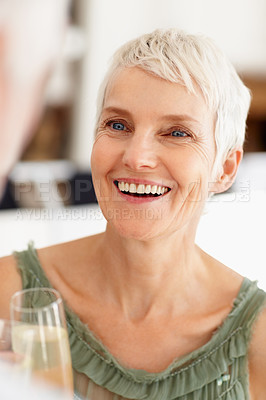Buy stock photo Happy old woman enjoying a glass of champagne