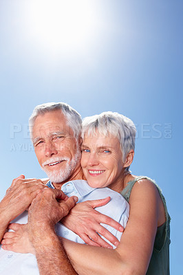 Buy stock photo Portrait of a mature woman with her arms around her husband, outdoors
