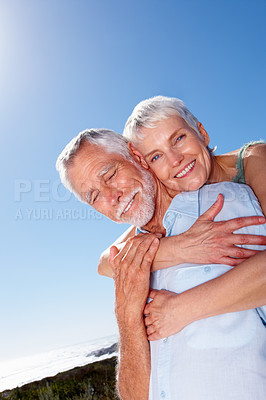 Buy stock photo Portrait of a senior woman with her arms around her husband, outdoors