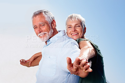 Buy stock photo Portrait of happy old couple enjoying themselves together, outdoors